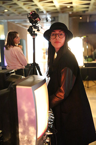 Yaara Bar ('19) at a projection design installation, Yale University Art Gallery, 2017. Photo by Joan Marcus.