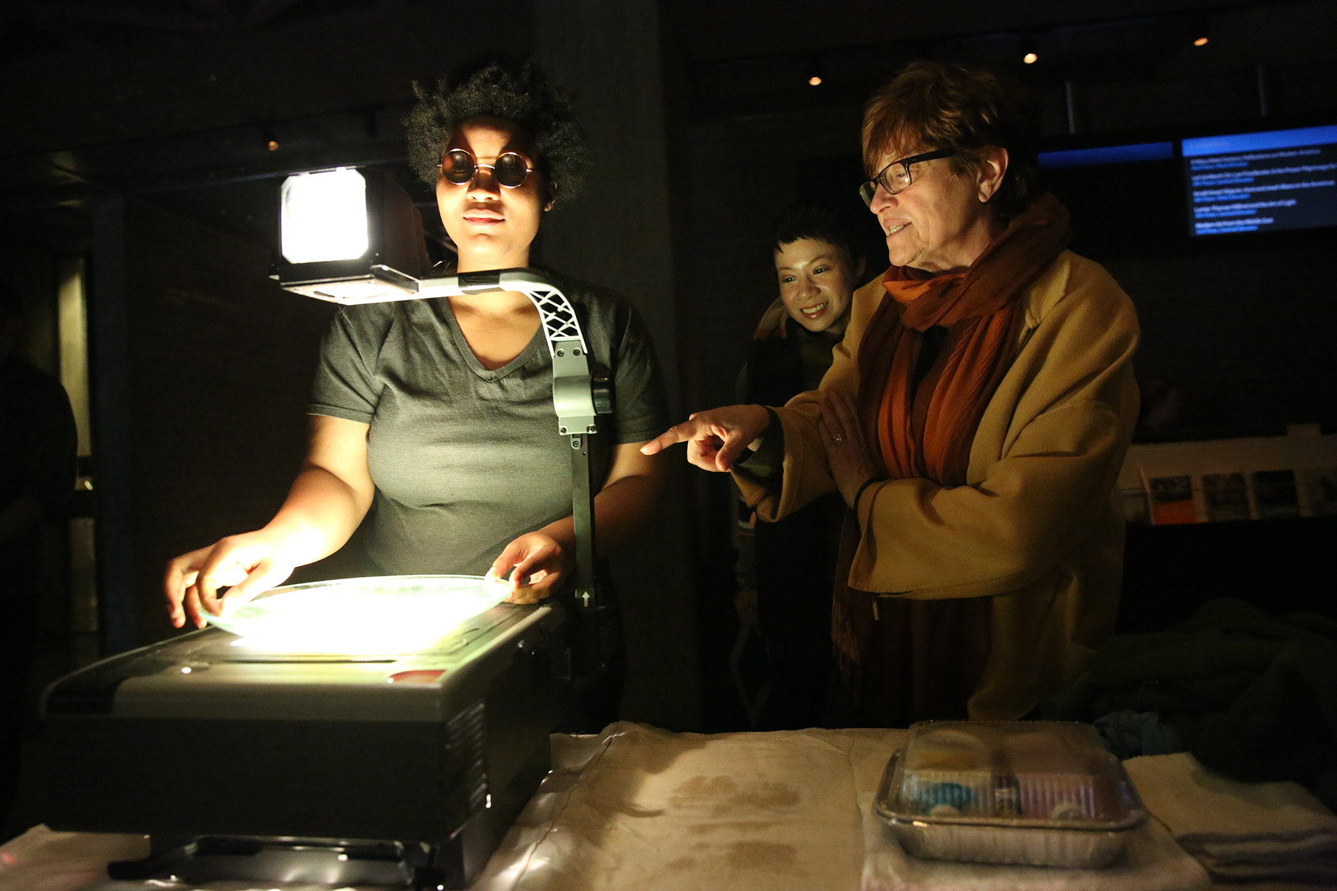 Brittany Bland ('19) with Wendall Harrington (Faculty) at a projection design installation at Yale University Art Gallery, 2017. Photo by Joan Marcus.