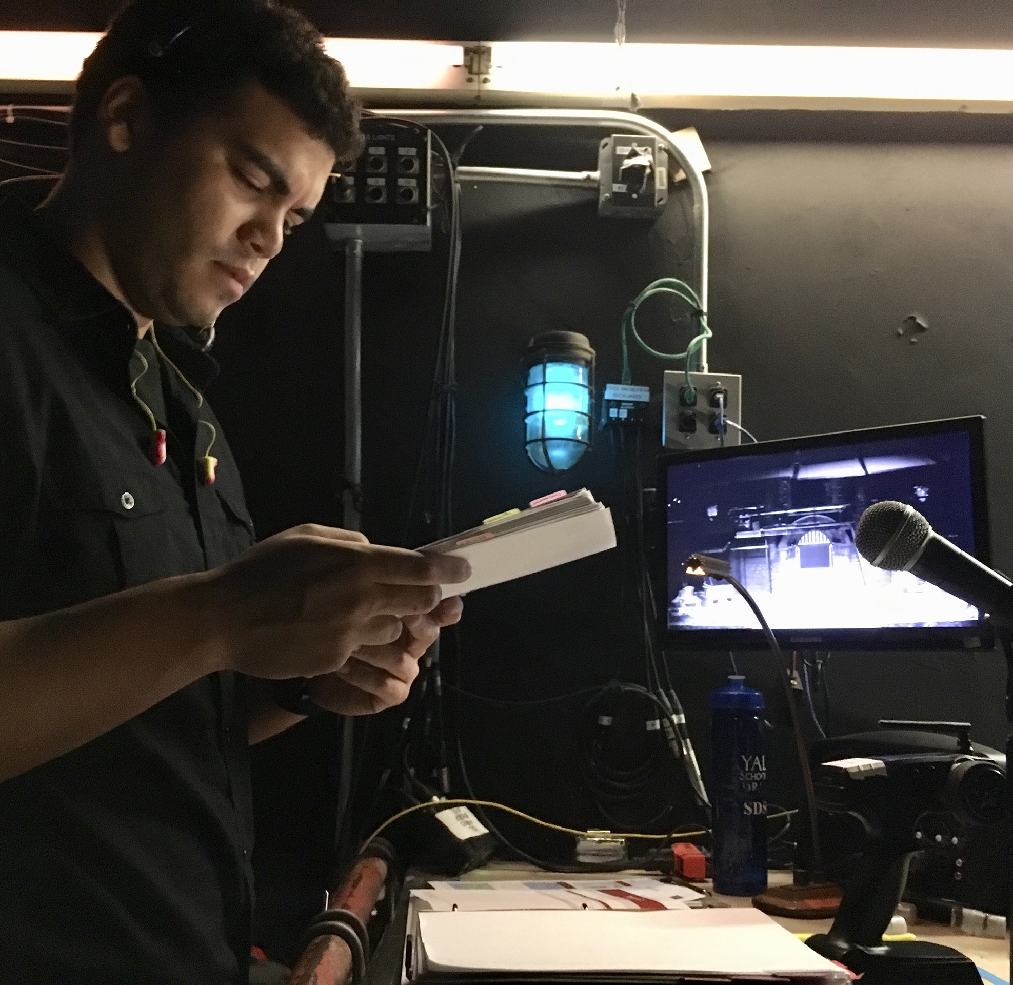Assistant Stage Manager Zachry J. Bailey ('20) backstage during a technical rehearsal for PENTECOST, Yale School of Drama, 2017. Photo by Christina Fontana ('19).
