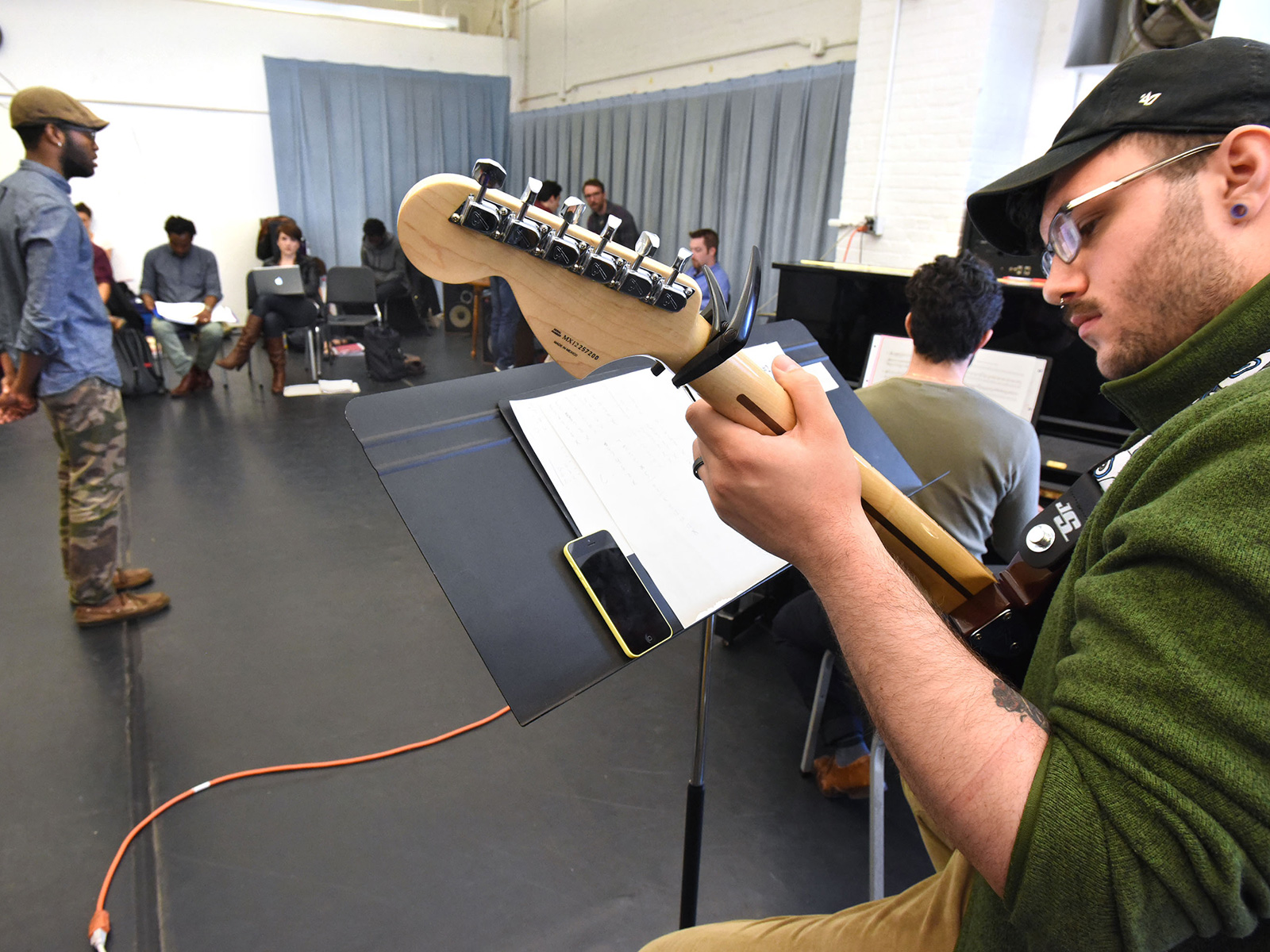 The sitzprobe rehearsal for <em/>The Children by Philip Howze ('15) in the Julie Harris Room at 149 York, Room 109.